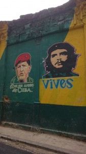 Street art depicting Ché  Guevara, 'you live on', and the late Venezuelan president Hugo Chávez 'Cuba's best friend'